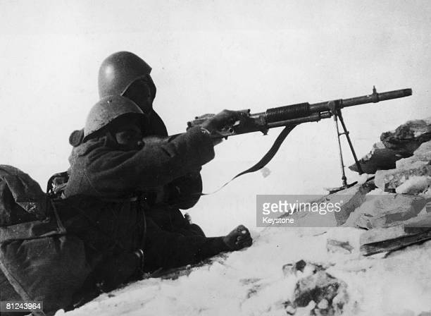 Greek soldiers operate a light machine gun in Albania, whilst attempting to repel the Italian invasion of Greece during World War II, circa 1941....