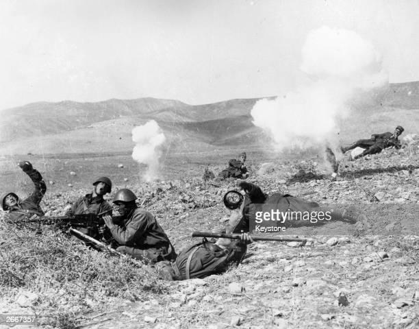 Greek soldiers practice throwing hand grenades after Greece declares war on Italy