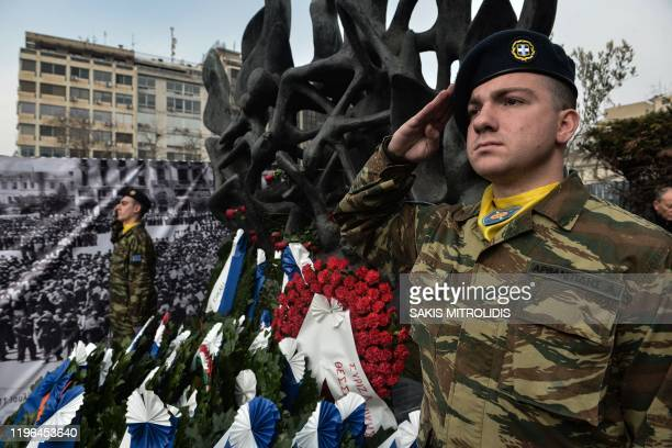 Greek soldiers stand next the Holocaust Memorial monument downtown Thessaloniki on January 26 during the International Holocaust Remembrance Day...