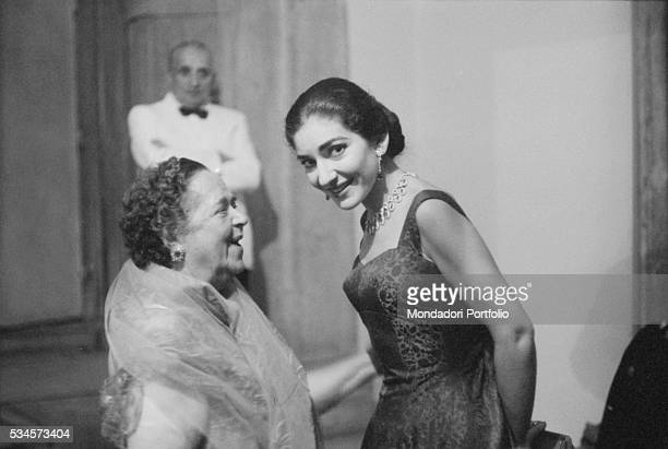 Greek soprano Maria Callas and American journalist Elsa Maxwell attending to a party during the XVIII Venice International Film Festival Venice 1957