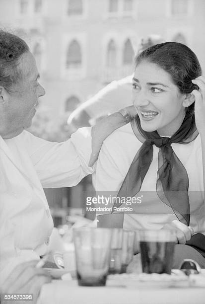 Greek soprano Maria Callas joking with American journalist Elsa Maxwell eating on the beach during the XVIII Venice International Film Festival...