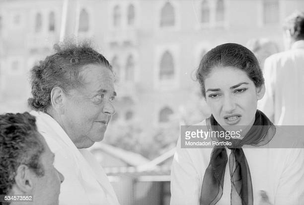 Greek soprano Maria Callas relaxing with American journalist Elsa Maxwell during the XVIII Venice International Film Festival Venice 1957