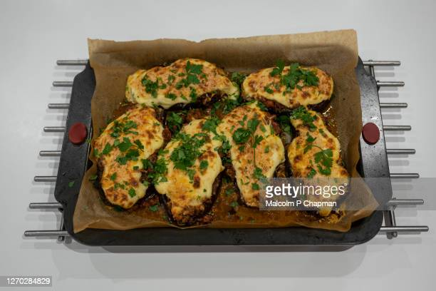 greek stuffed aubergine - melitzanes papoutsakia - greece stock pictures, royalty-free photos & images
