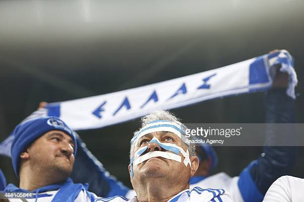 Greek supporters cheer their team during Hungary v Greece European Euro 2016 qualification soccer match at Grupama Arena in Budapest March 29 2015