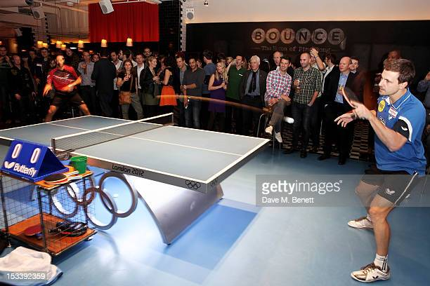Greek table tennis player Panagiotis Gionis and German professional table tennis player Timo Boll play at the launch of Bounce Holborn's new Ping...