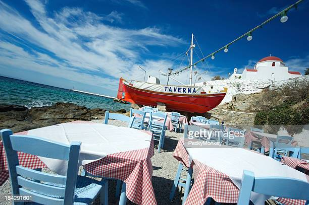 Greek Taverna Features Bright Red Fishing Boat