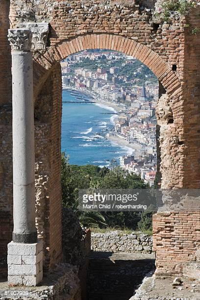 greek theatre and view of giardini naxos, taormina, sicily, italy, europe - giardini naxos stock pictures, royalty-free photos & images
