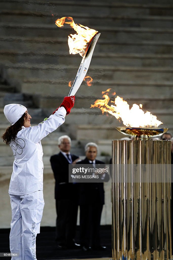 Greek torch bearer Niki Georgiadou lights the altar with the