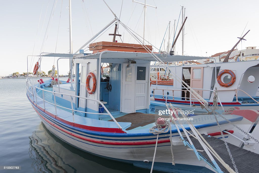 Greek traditional fishing boat on Pythagoreion. : Stock Photo