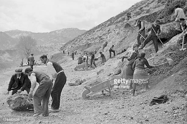 Greek villagers suspected of supporting antigovernment leftwing guerillas are forced to work widening roads during the Greek Civil War May 1948...