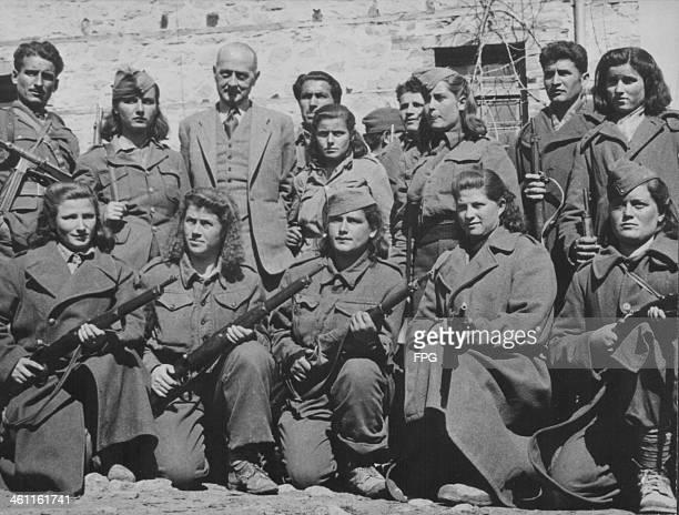 Greek women aiding the war effort during World War Two, with Lieutenant Maurice Delvoie of Belgium, Greece, circa 1939-1945.