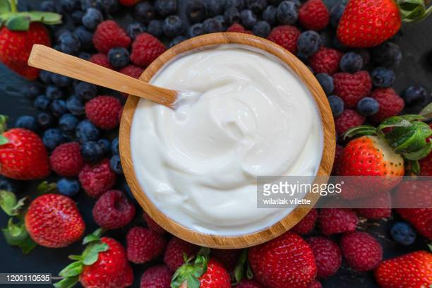 greek yogurt in a glass jars with spoons,healthy breakfast with fresh greek yogurt, muesli and berries on background - yoghurt stock pictures, royalty-free photos & images