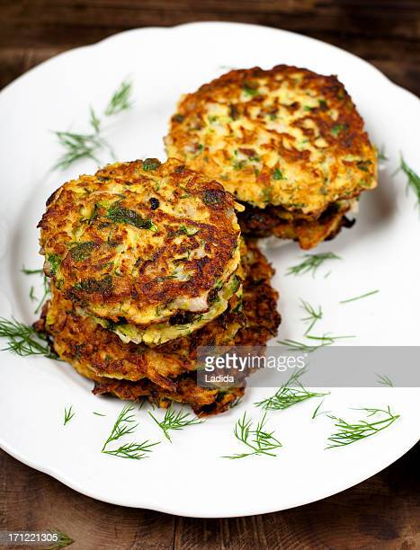greek zucchini fritters - fritter stock photos and pictures