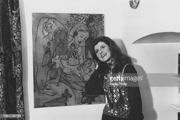 GreekAmerican author Arianna Stassinopoulos pictured next to a piece of art photographed in her home for Radio Times in connection with her...