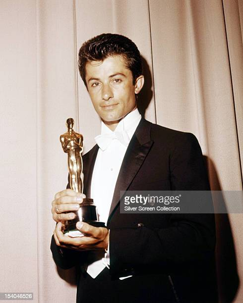 GreekAmerican dancer and actor George Chakiris with his oscar for Best Supporting Actor for 'Westside Story' at the 34th Academy Awards held at Santa...