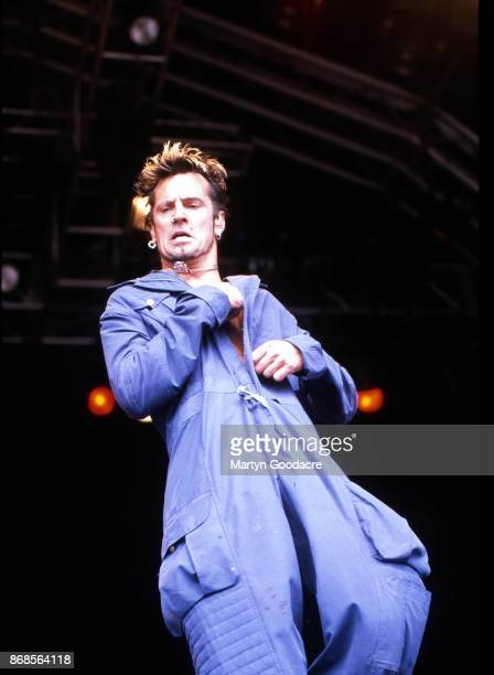 GreekAmerican musician Tommy Lee performs on stage with Masters Of Mayhem Glastonbury Festival United Kingdom 23rd June 2000
