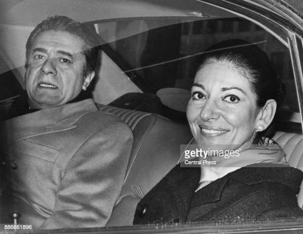 Greek-American soprano Maria Callas leaves the Royal Festival Hall in London with her co-star, Italian tenor Giuseppe Di Stefano , after rehearsals...