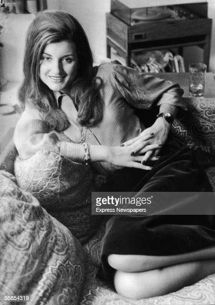 Greekborn American columnist and political commentator Arianna Huffington reclines on a couch as she poses for a portrait 1974 At the time she lived...