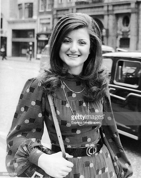 Greekborn American columnist and political commentator Arianna Huffington stops and poses for a photograph on a city street 1975