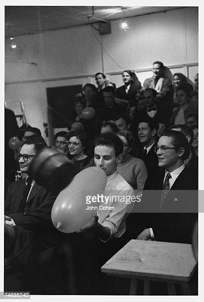 Greekborn American photographer and artist Lucas Samaras holds a balloon at an exhibition in the Reuben Gallery New York New York late 1959 The event...