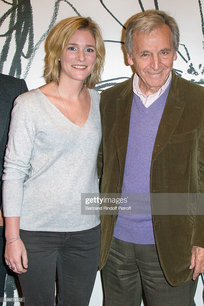 Greek-born filmmaker Costa-Gavras (R) and actress Natacha Regnier pose as they attend 'Le Capital' premiere at Gaumont Parnasse on November 12, 2012 in Paris, France.