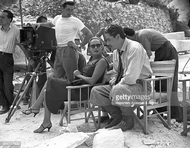 Greekborn Italian actress Yvonne Sanson and Italian actor Amedeo Nazzari having a break on the set of the film Nobody's Children shooted at Carrara...
