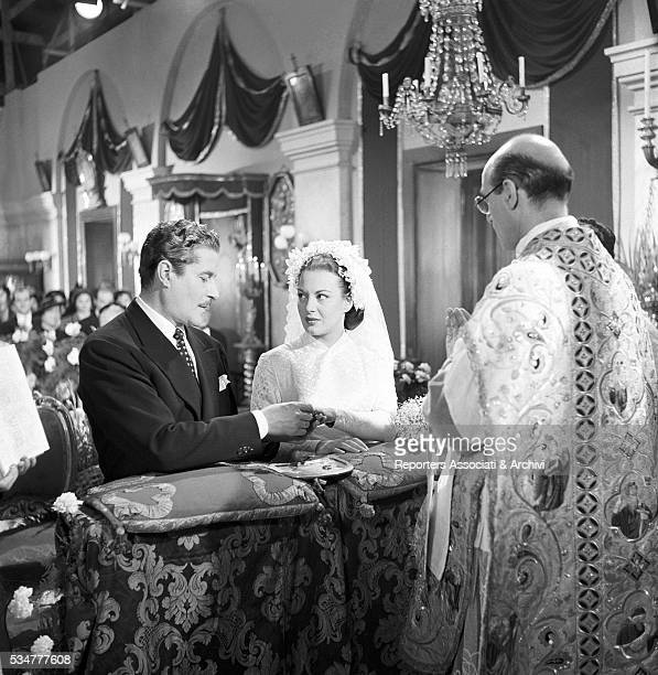 Greekborn Italian actress Yvonne Sanson and Italian actor Amedeo Nazzari getting married in the film Torna 1953