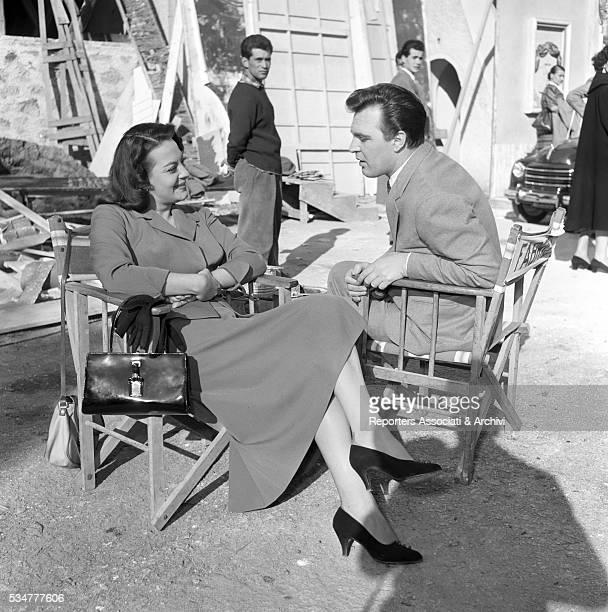 Greekborn Italian actress Yvonne Sanson and Italian actor Franco Fabrizi chatting on the set of the film Torna 1953