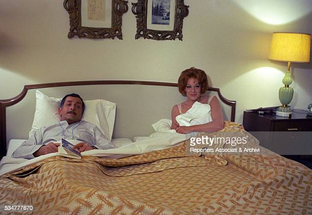 Greekborn Italian actress Yvonne Sanson and Italian actor Riccardo Garrone lying in bed in the film Il ragazzo che sorride 1968