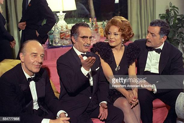 Greekborn Italian actress Yvonne Sanson and Italian actors Riccardo Garrone and Nino Taranto sitting on the sofa in the film Il ragazzo che sorride...