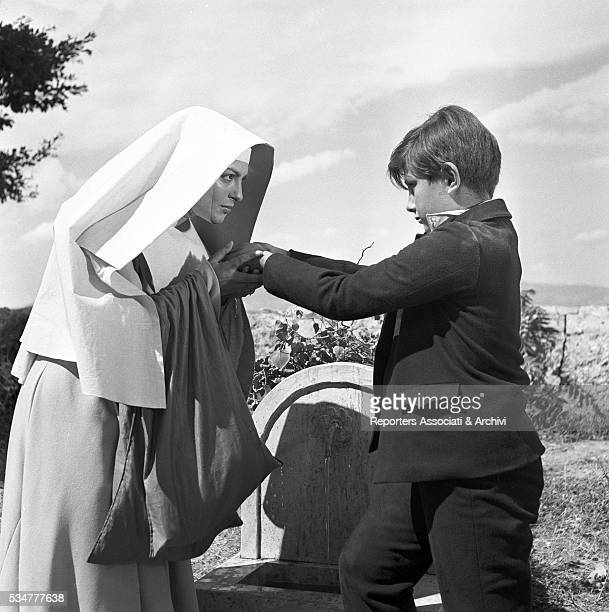 Greekborn Italian actress Yvonne Sanson as Sister Addolorata holding the hands of a child in the film Nobody's Children 1951