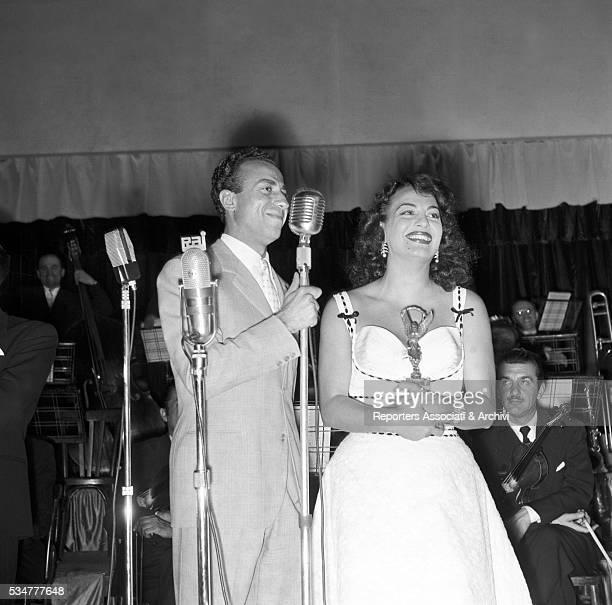 Greekborn Italian actress Yvonne Sanson being awarded by Italian actor Silvio Noto Rome 1952
