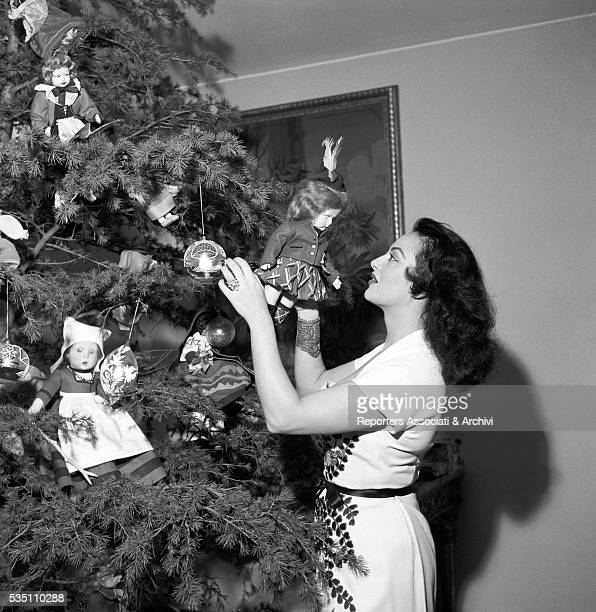 Greekborn Italian actress Yvonne Sanson decorating the Christmas tree in her villa on the Appian Way Rome December 1955