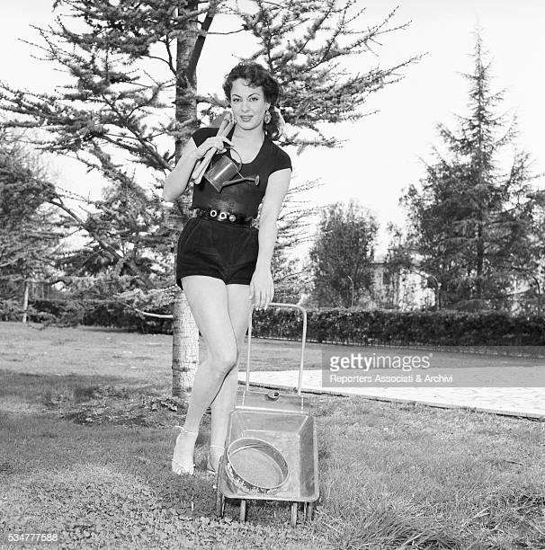 Greekborn Italian actress Yvonne Sanson gardening in her villa on the Appian Way in Rome 1952