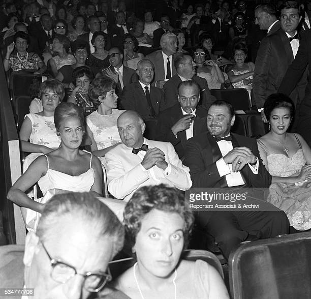 Greekborn Italian actress Yvonne Sanson Italian director Duilio Coletti and American actor Ernest Borgnine attending the presentation of the film The...