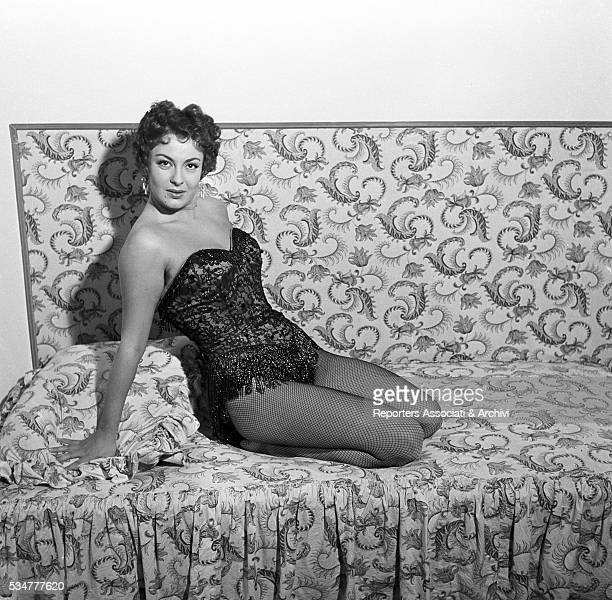 Greekborn Italian actress Yvonne Sanson posing in a sexy attitude during a break on the set of the film Nobody's Children 1951