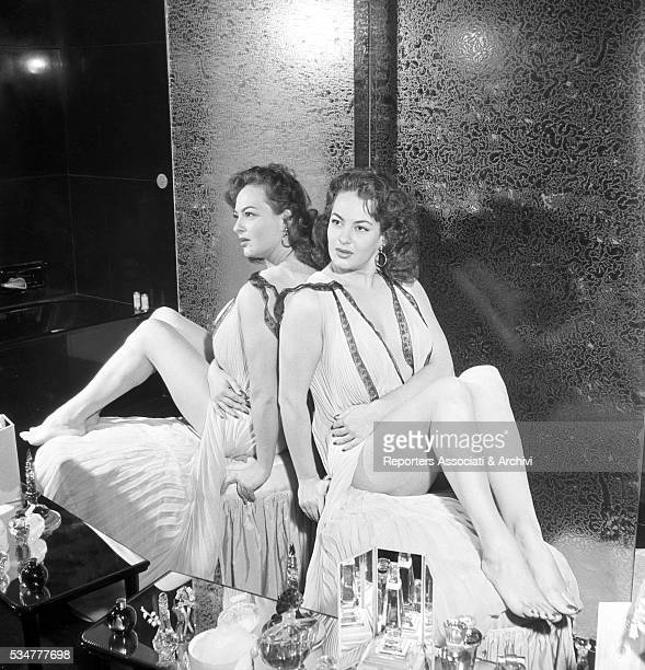 Greekborn Italian actress Yvonne Sanson reflected by the mirror in the bathroom of her villa on the Appian Way in Rome Rome 1955