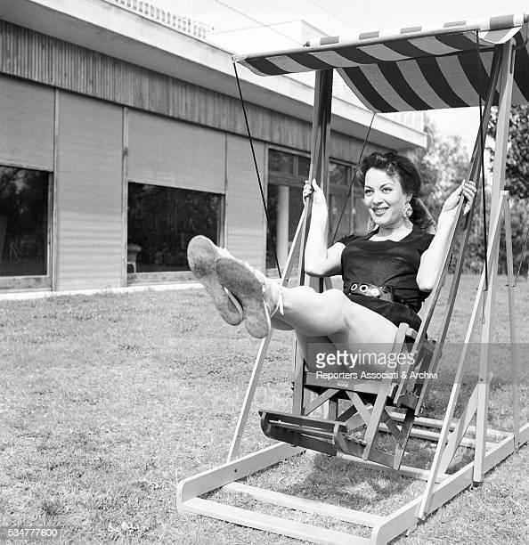 Greekborn Italian actress Yvonne Sanson swinging on the swing 1952