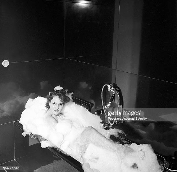 Greekborn Italian Yvonne Sanson relaxing in the tub in the bathroom of her villa on the Appian Way in Rome Rome 1955