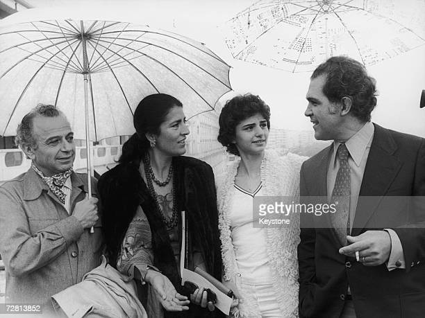 Greek-Cypriot film director Michael Cacoyannis at the Cannes Film Festival with the stars of his latest film 'Iphigenia', 16th May 1977. From second...