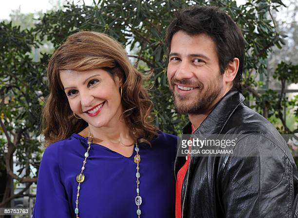 GreekUS actress and screenwriter Nia Vardalos and Greek actor Alexis Georgoulis pose during a press conference in Athens to present their new movie...