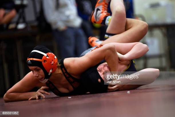 Greeley Central wrestler Kaden Campbell picks up back points on her way to a win over Brandee Greerr of Legacy High School during the Chatfield High...
