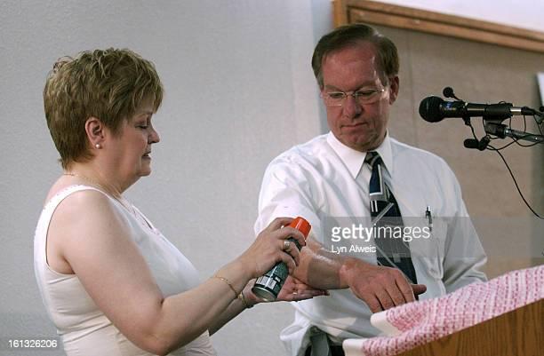 May 24 2004'Susan Little left Executive Director DEET Education Program<cq> sprays insect repellent on the arm of US Senator Wayne Allard <cq>at at...