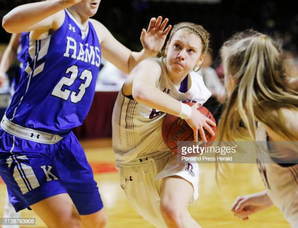 Greely Anna DeWolfe looks to the basket around Kennebunk Emily Archibald in first half girls semifinal action in the MPA State Tournament at the...