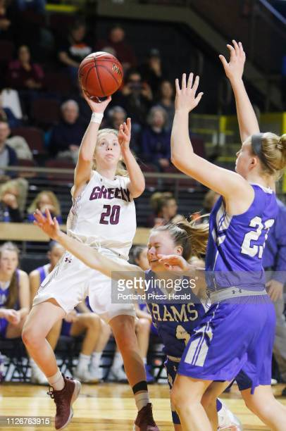 Greely Anna DeWolfe sends up a shot as Kennebunk Guliana Dupler and Emily Archibald defend in first half girls semifinal action in the MPA State...