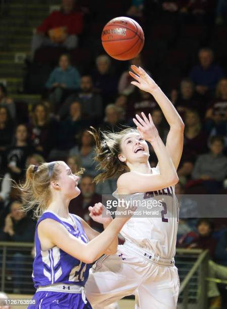 Greely Camille Clement sends up a shot with pressure from Kennebunk Alaina Schatzabel in fourth quarter girls semifinal action in the MPA State...
