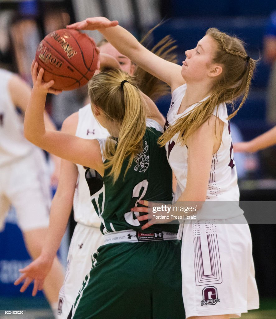 Greely guard Anna DeWolfe gets her hand on the ball being passed by Leavitt guard Alison Noniweicz during girls Class A South quarterfinals on Monday, February 19, 2018 at the Portland Expo.