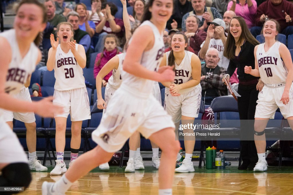 Greely team members, on the bench and on the court, cheer a late game basket on the way to beat Leavitt in the Class A South quarterfinals on Monday, February 19, 2018 at the Portland Expo.