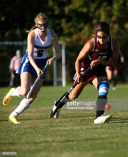 Greely vs Kennebunk field hockey Chloe Smith of Kennebunk left moves the ball up the field as Alyssa Coyne of Greely defends during the first half
