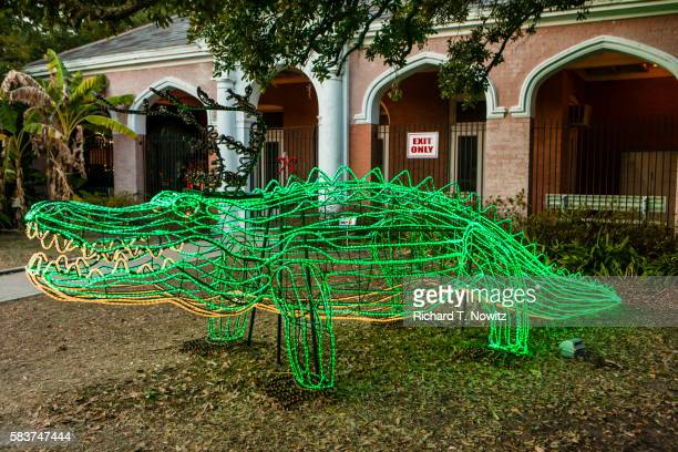 green aligator christmas decoration - new orleans christmas stock pictures, royalty-free photos & images